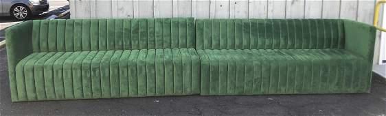 Large green upholstered sofa