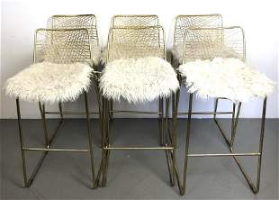 A Group of 6 Gold Tone Bar Stools