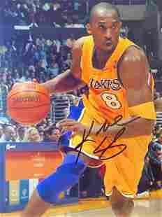 Autographed Kobe Bryant dribbling Photo