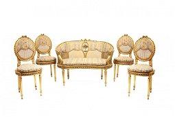 Canapé y cuatro sillas estilo Luis XVI  con asiento de