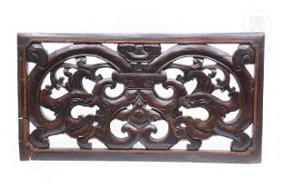 Decorative carved wooden panel.