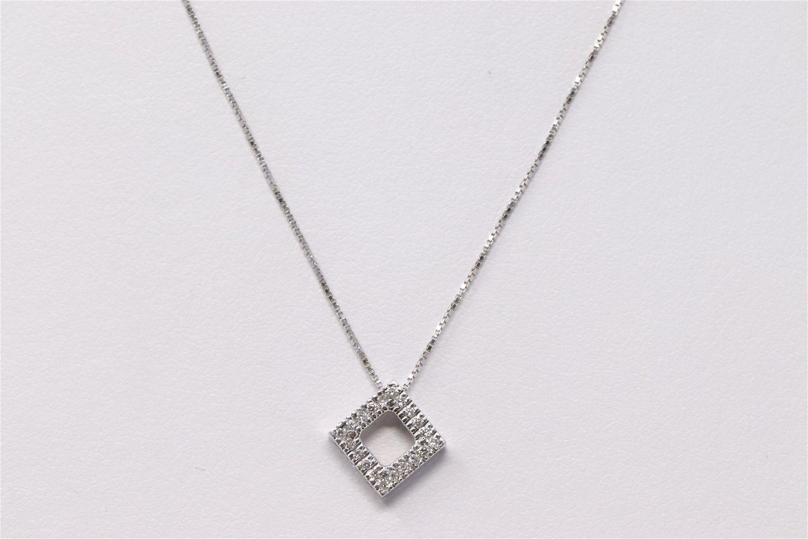 14Kt White Gold Diamond Pendant.