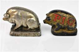 Pair of Cast Iron Pig Advertising paperweights