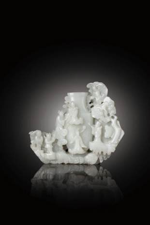 A WHITE JADE VASE WITH TAOIST FIGURES, 18TH CENTURY