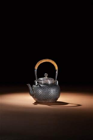 A JAPANESE SILVER TEAPOT WITH DOTTED PATTERN