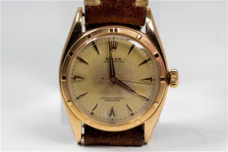 Vintage Rolex Oyster Perpetual Wristwatch in 18k Yellow
