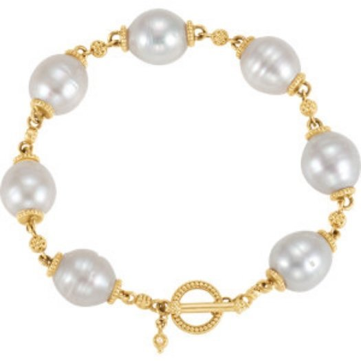 14K GOLD BRACELET WITH 7 FINE 11MM SOUTH SEA PEARLS