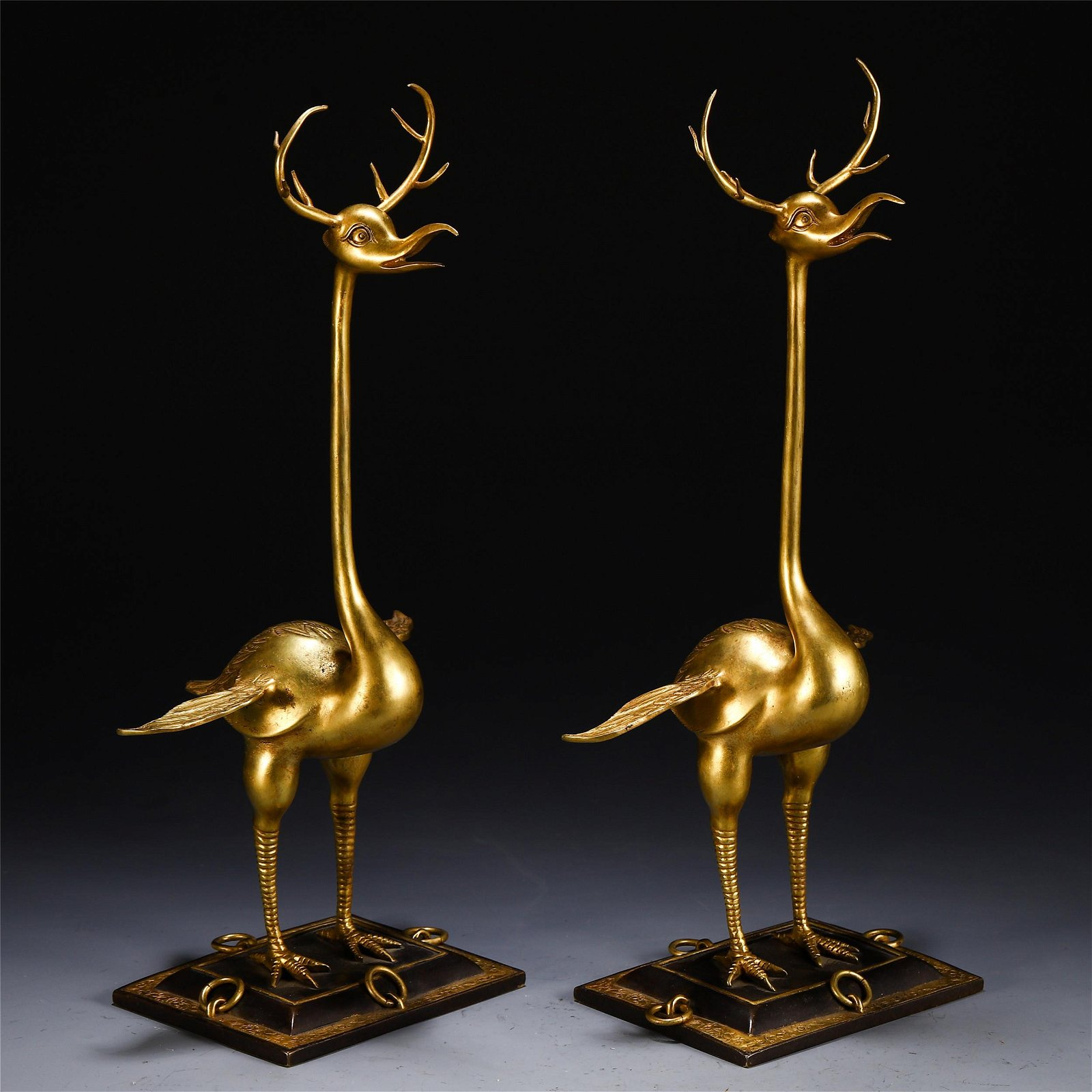 A PAIR OF CHINESE GILT BRONZE BEAST TABLE ITEM