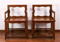 A PAIR OF CHINESE HARDWOOD CARVED ARMCHAIRS