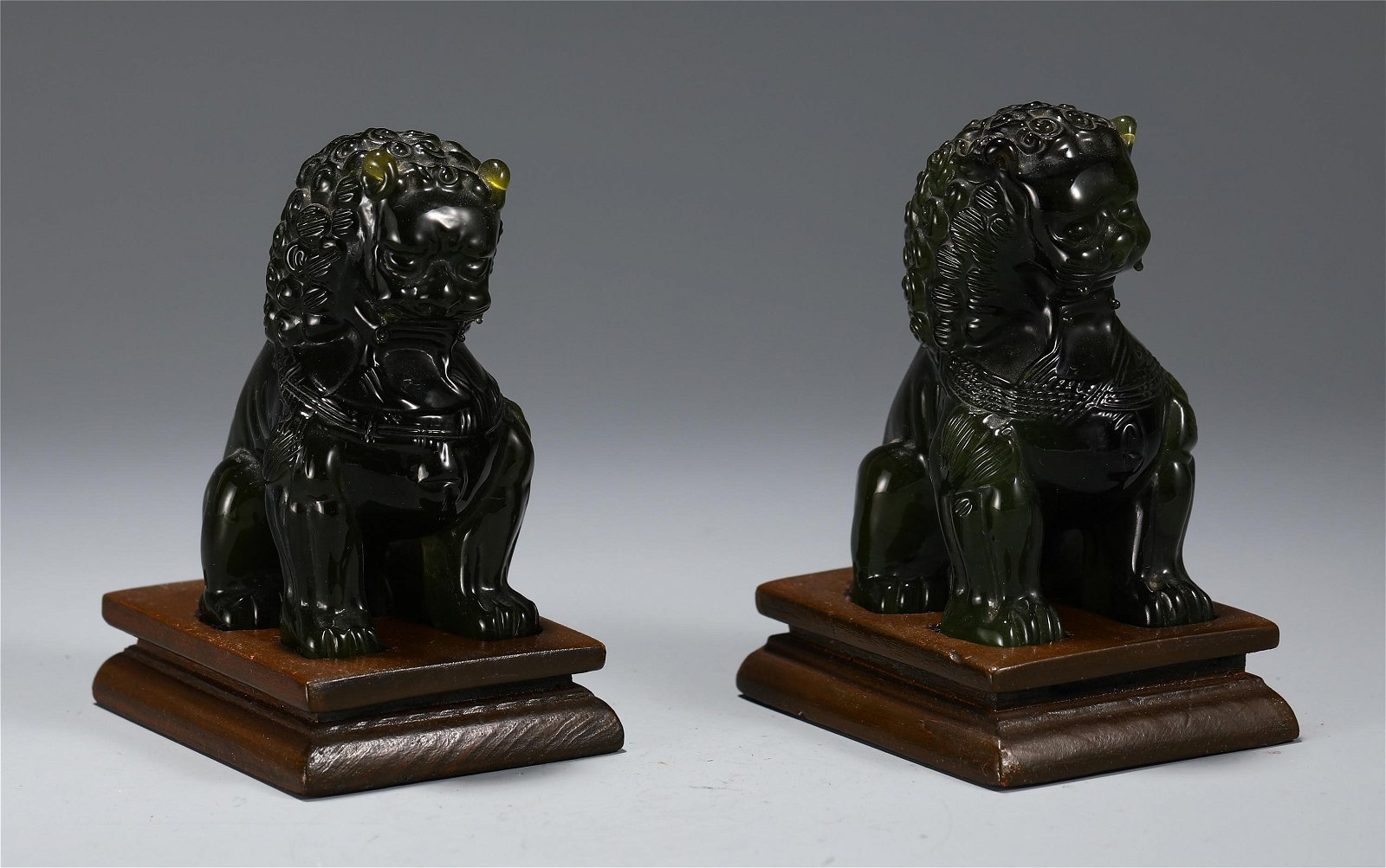 A PAIR OF CHINESE ROCK CRYSTAL RECUMBENT LION TABLE