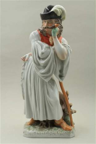 Porcelain male figure leaning on a cane