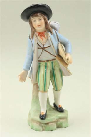 A figure of a boy in porcelain