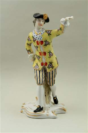 A young male figure in a colorful outfit