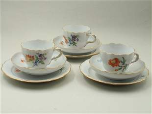 A set of six plates, saucers and cups