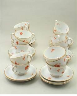 A set of 17 cups of coffee and saucers with a delicate