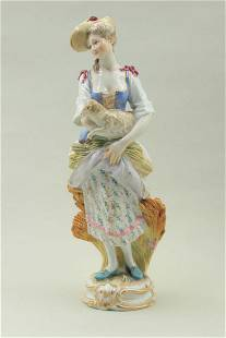 A figure of a young girl holding a lamb