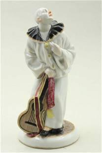 Porcelain clown figure with a guitar