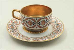 Pink and gold cup and saucer in a very delicate