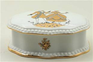 A small porcelain box with a matching lid decorated