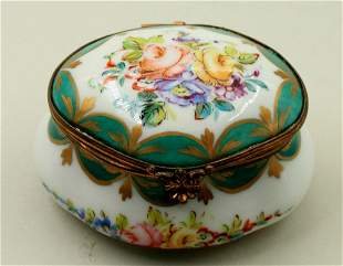 A small round porcelain bowl for sugar with a lid