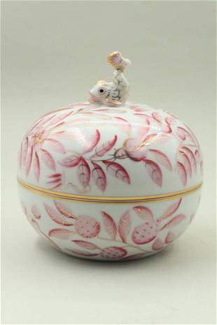 Porcelain bowl with a bird figure on the lid
