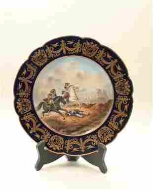 A 25 cm diameter plate with a war scene