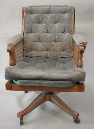 A pair of wooden armchairs