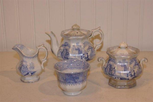 1002: 19th C English Ironstone Child's Tea Set