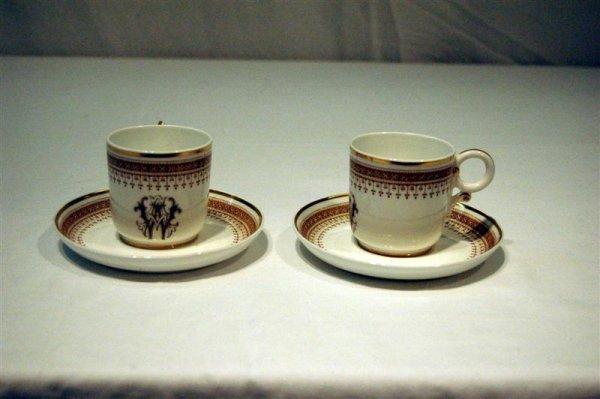 1018: 7 DEMITASSE CUPS & SAUCERS