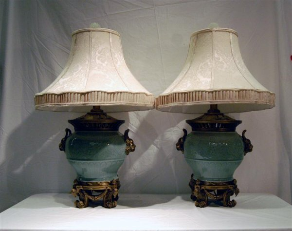 2142: PAIR OF CELEDON LAMPS WITH LIONS HEAD