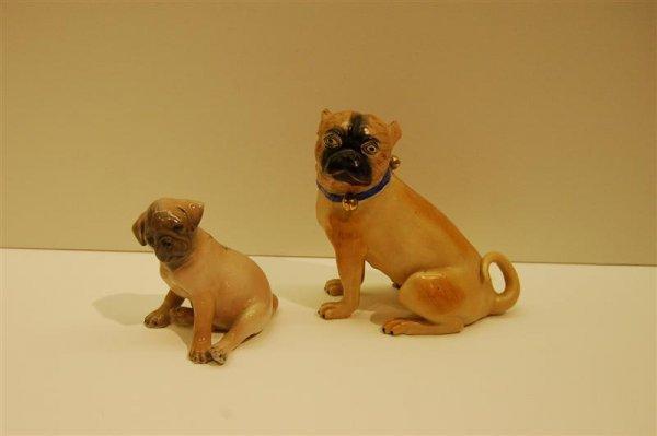 1122: TWO PUG DOG FIGURINES