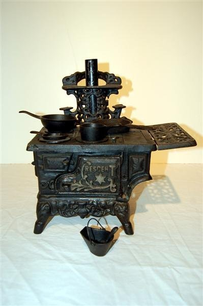8: CHILD'S CRESCENT IRON STOVE WITH POTS & PANS - 10 3/