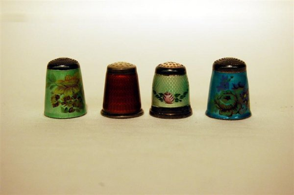12: FOUR ENAMEL ON STERLING THIMBLES
