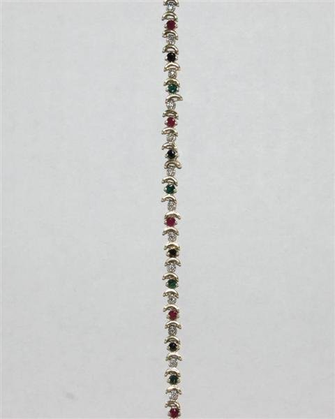 393: 10K GOLD TENNIS BRACELET WITH MULTI COLORED STONES