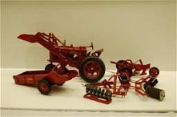 77: McCORMICK METAL FARM TRACTOR W/ ATTACHMENTS