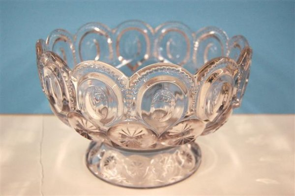 """619: CLEAR """"MOON AND STAR"""" PATTERN GLASS FOOTED BOWL, A"""