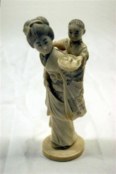 14: JAPANESE IVORY FIGURINE - WOMAN CARRYING SOW - MAIJ