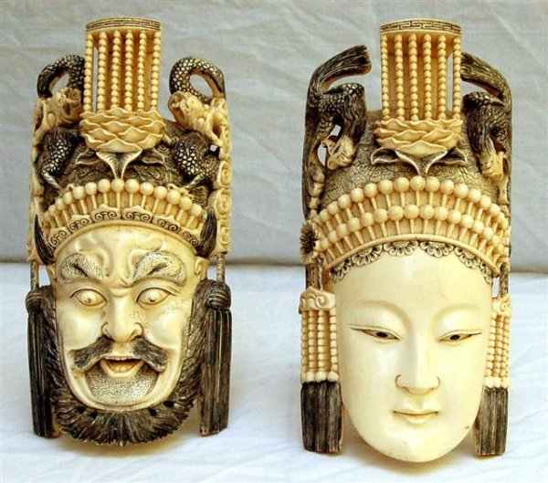 """Two Carved Ivory Masks, Female and Male - 9"""" tall"""