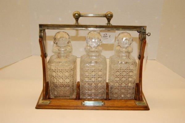 67: 19th Century English Tantulus Set w/ Three Cut Glas