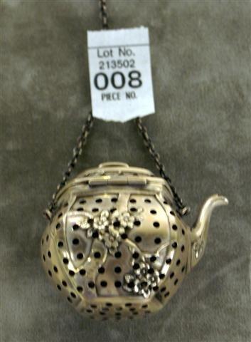 8: Sterling Tea Pot Motif Tea Strainer - marked R. CO.