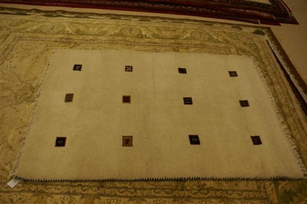 11: Hand Knotted Indo Gabbeh - approximately 4' x 5' 11