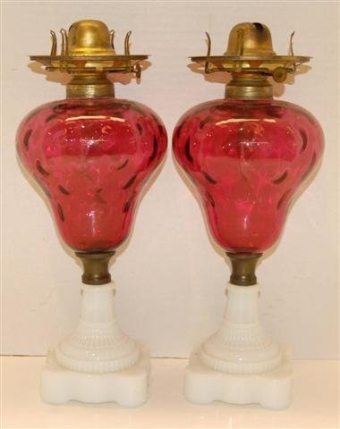 7: Pr. of 19th Century Oil Lamps - cranberry glass font