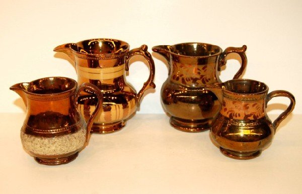 18: Four English Copper Luster Cream Pitchers