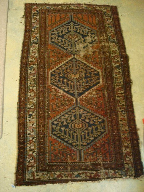 9: Antique Persian Area Rug - worn