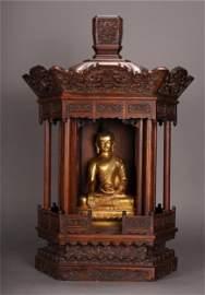 GILT BRONZE SAKYAMUNI BUDDHA SEATED STATUE IN ROSEWOOD