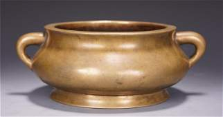 A CHINESE DOUBLE HANDLE BRONZE ROUND CENSER