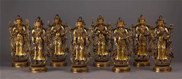 A SET OF CHINESE GILT BRONZE STANDING GUANYIN STATUE ON