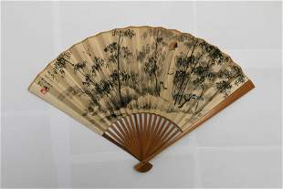 CHINESE FOLDING FAN WITH PAINTING OF FIGURE IN BAMBOO