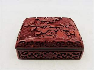 A CHINESE CARVED RED LACQUER FLORAL PATTERN BOX AND