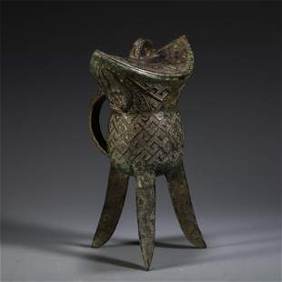 A CHINESE BRONZE JUE CUP